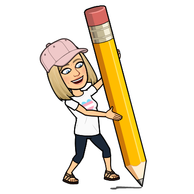 Mrs. Grady holding a giant pencil.