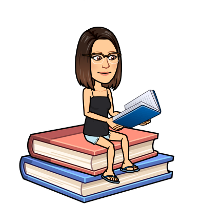 Mrs. Wilson sitting on an over-sized stack of books reading a book