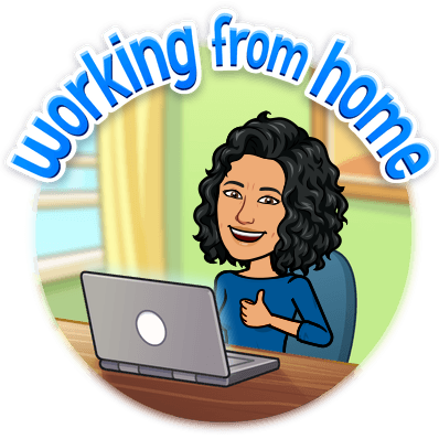 A person working from home, giving a thumbs up over their laptop